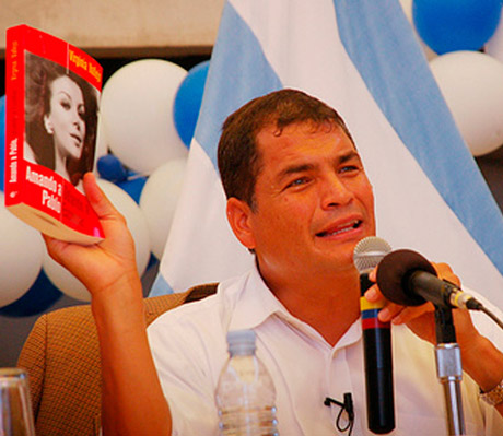President Rafael Correa of Ecuador shows Virginia's book in camera, 2008